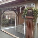 Verandazeil geplaatst bij houten terrasoverkapping